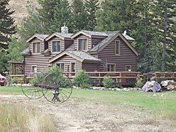 Canyon Cabins, cabin, log home, Red Lodge, Montana, Rock Creek, acres, guest house, remodel, log barn, bar, outhouse, storage, floor heat, modern, dining nook, rock fireplace, fire