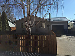 home, St. Anthony, Idaho, fenced yard, garage, storage, area, renovation, trees, garden, RV, for sale