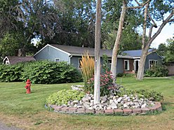 home, house, for sale, Choteau, Montana, corner lot, maintained yard, fireplace, garage, fenced for sale