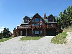 Polson, Kalispell, Lake Mary Ronan, Montana, fenced garden, stone fireplace, hickory floors, walk out basement, garage, heated shop, lean-to, Proctor Valley, Mission Mountains, fla