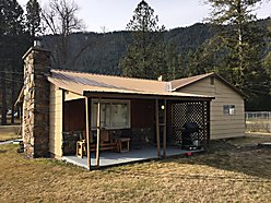 home, for sale, Clark Fork River, Superior, Montana, patio, fireplace, views, garage, garden shed for sale