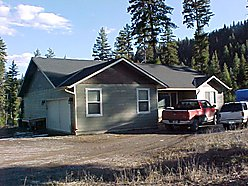 Home for sale, Superior, Montana, garage, home, house, trees, acre, acreage, National Forest, land for sale
