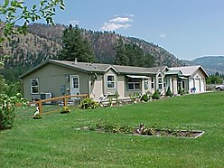 Superior, Montana, Riverfront, sandy beach, island, breakfast bar, triple garage, covered patio for sale