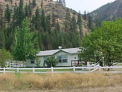 Superior, Montana, manufactured home, acres pastureland, fenced yard, covered back deck