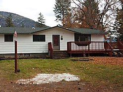home, acre, lot, trees, clark fork river, river, deck, garage, private, spetic, well, basement, storage, superior montana, montana,