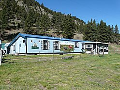 acres, for sale, home, wolf creek, montana, sheds, work shop, creek frontage, craig, fly fishing,  for sale
